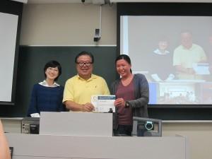 Representative Student for Sanriku Fieldwork 2014 receiving Completion Certificate from Professor Jun Murai and Professor Satoko Oki